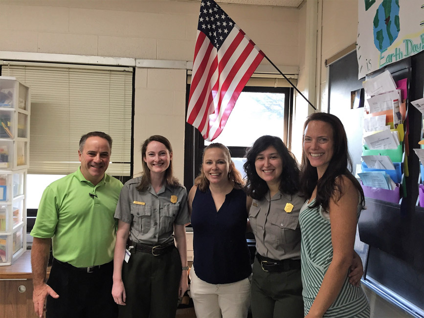 Chair of Humanities Joseph Leavy with Sagamore Hill National Park Service rangers Finley teachers.