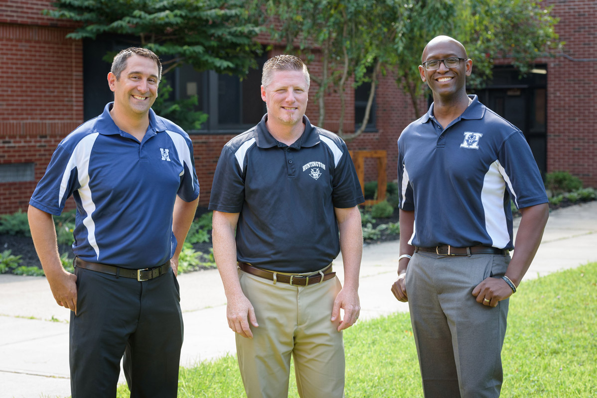 Brenden Cusack is flanked by Asst. Principals Gamal Smith and Joe DiTroia