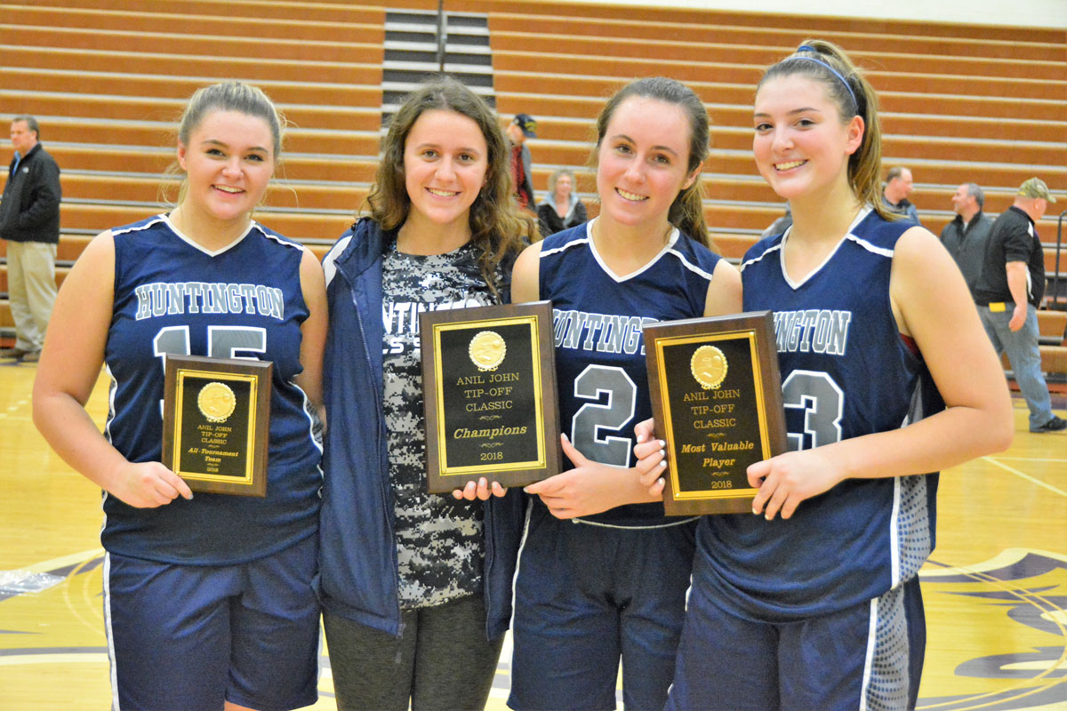 Christie Baade, Alyssa Sorensen, Paige Lennon and Abby Maichin show off Huntington's awards after winning the Islip tournament.