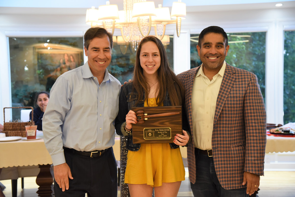 Legal advisors John LoTurco and Xavier Palacios with the Huntington mock trial team's Rookie of the Year Lia Shechter.