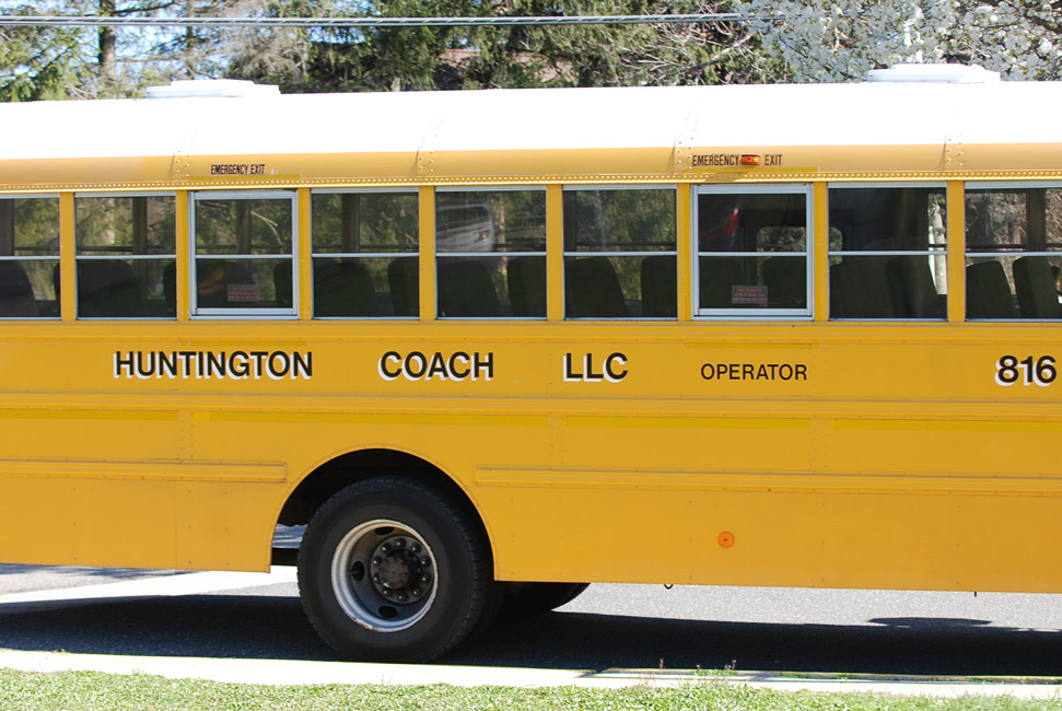 Huntington students stuffed a large school bus three times with food and donated the items to local pantries.