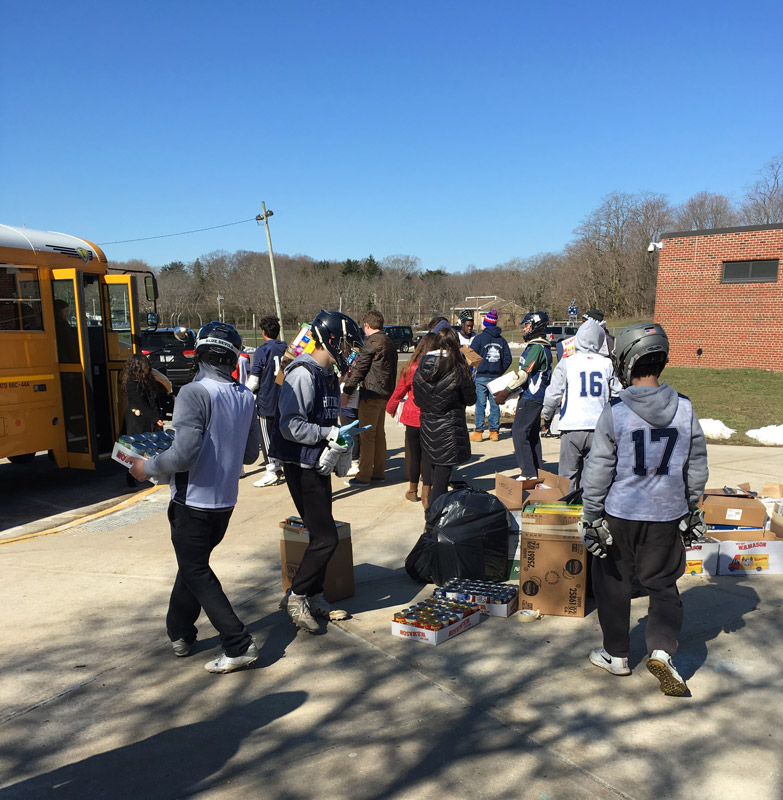 JV lacrosse players helped stuff the bus.