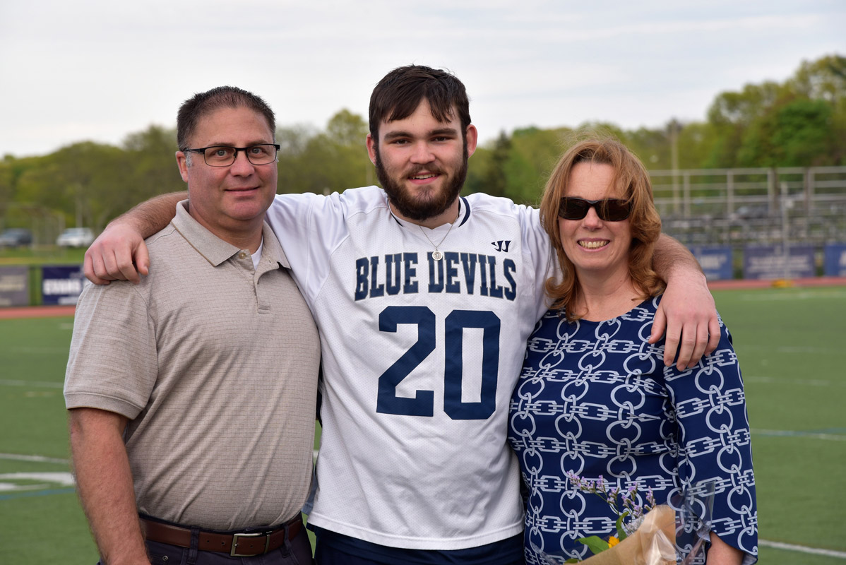 Chris Martin with his parents, Kevin and Karen on boys' lacrosse Senior Day at Blue Devil Stadium.