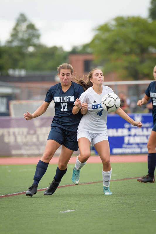 Marissa Stafford (left) mixes it up for the Blue Devils. (Darin Reed photo.)