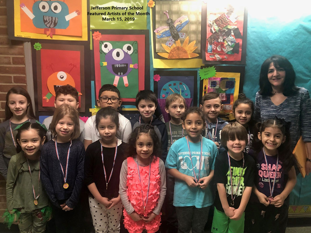 Art teacher Maria Mazzola with Jefferson School's Featured Artists of the Month for March.