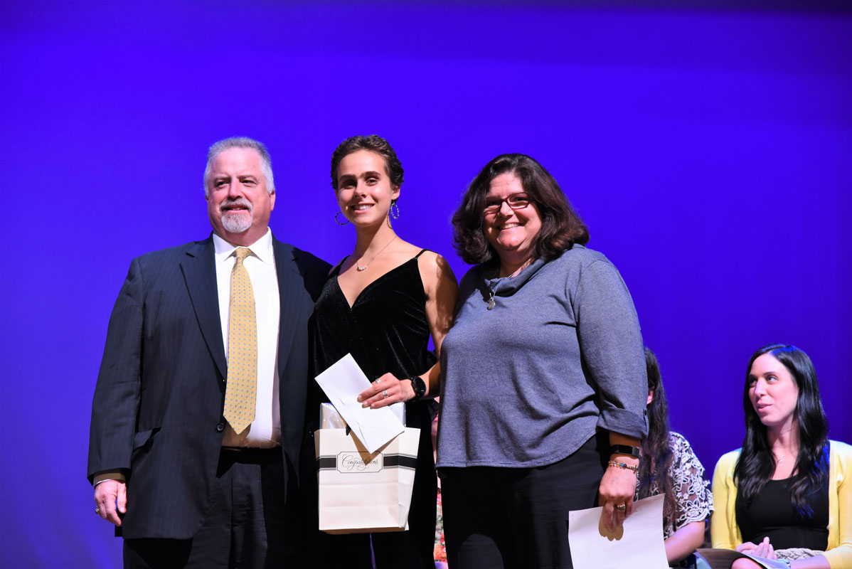 Glen and Anne Manaker flank Christina Nigro at last year's awards ceremony.