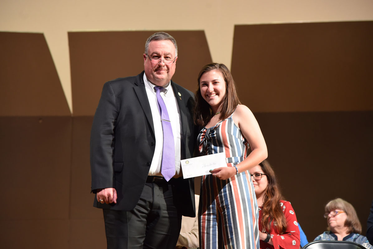 Phoebe Walther with the Rotary Club's Frank Plesche.