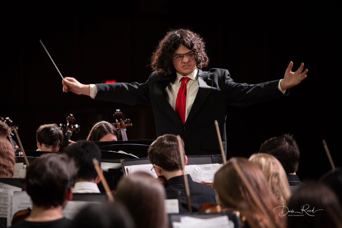 Senior Kyle Perea directs the orchestra at last week's winter concert. (Darin Reed photo)