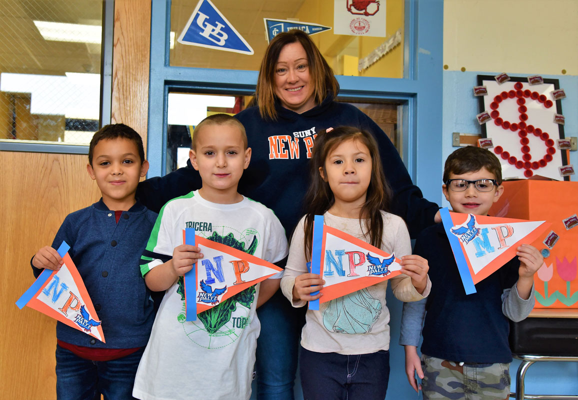 Washington School teacher Margaret Connors with students holding SUNY New Paltz pennants (1)