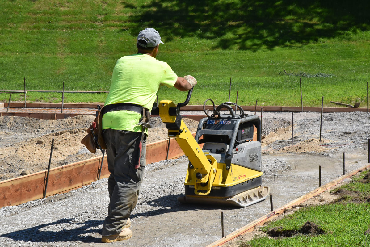 Work to install new sidewalks and curbs at Woodhull School is progressing well