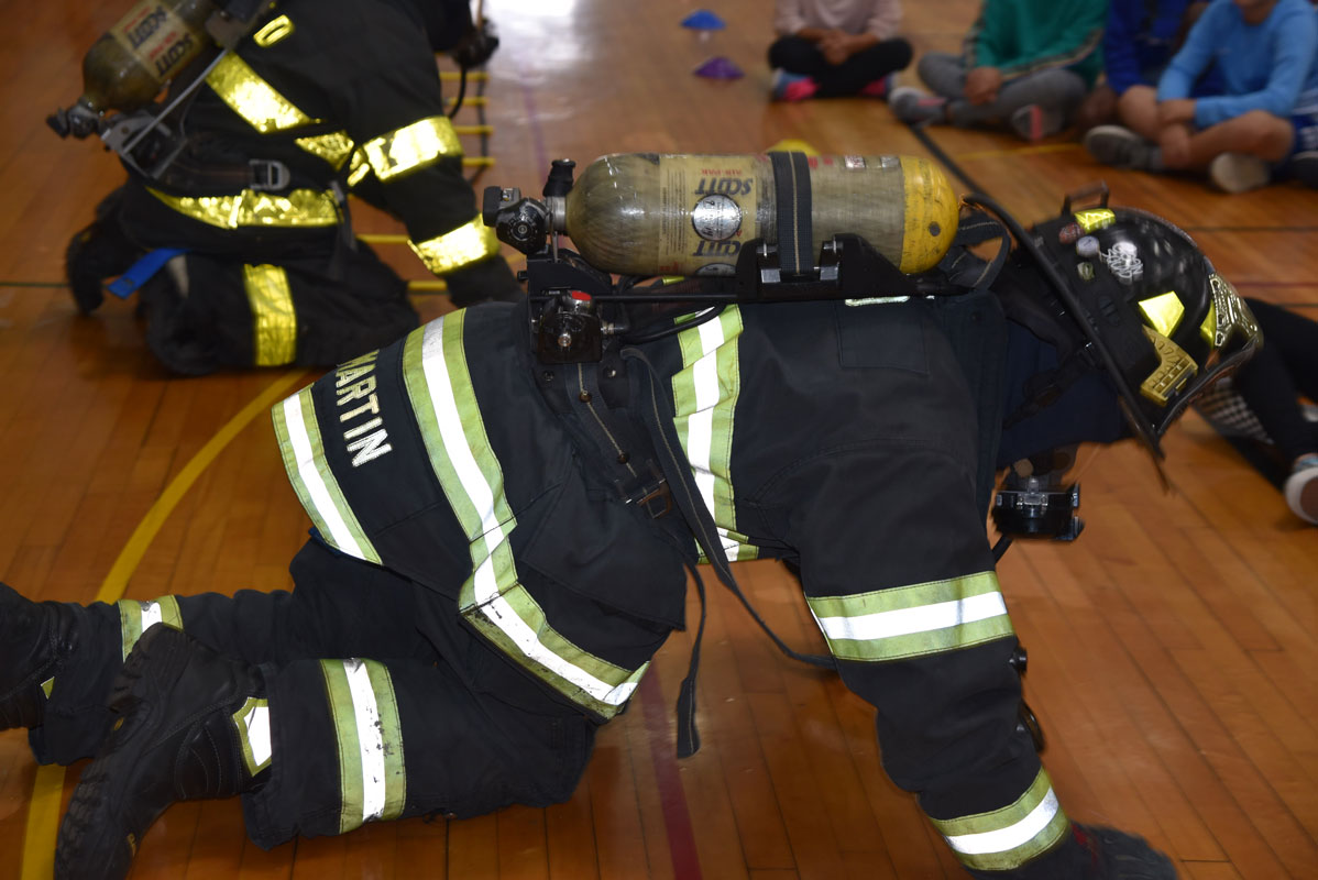 Firemen donned their emergency gear and demonstrated what they would do and say in a smoke filled house