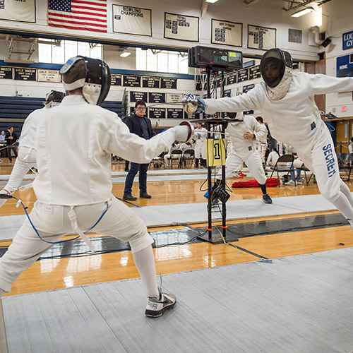 The Huntington boys' fencing team gained valuable experience this past winter. (Darin Reed photo)