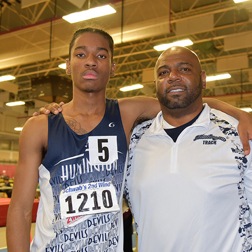 Huntington junior Jonathan Smith with Blue Devil track head coach Ronald Wilson.